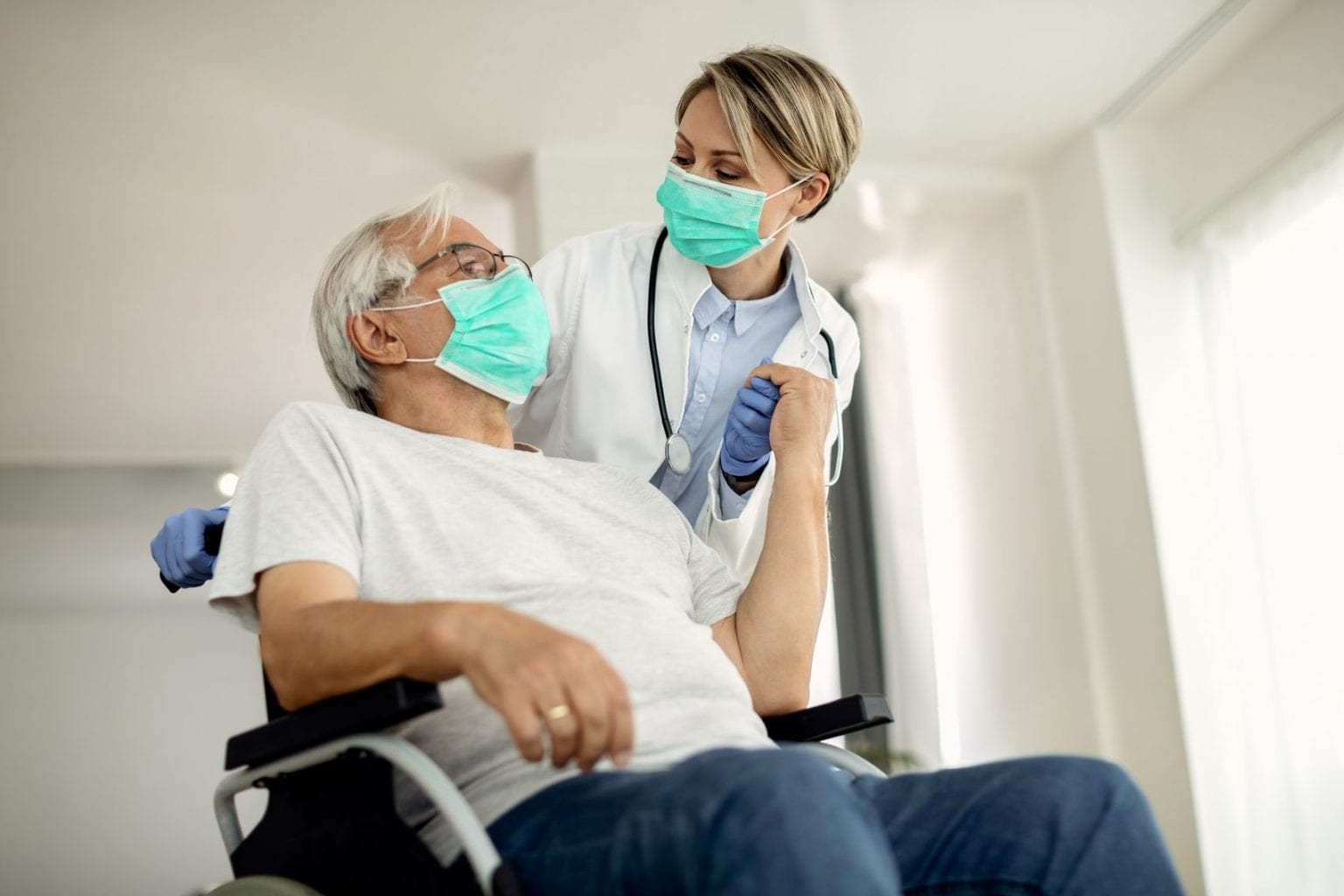 Patient in a wheelchair receiving home health and hospice care