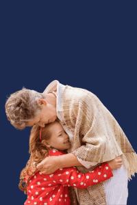 Grandmother and grandchild embracing