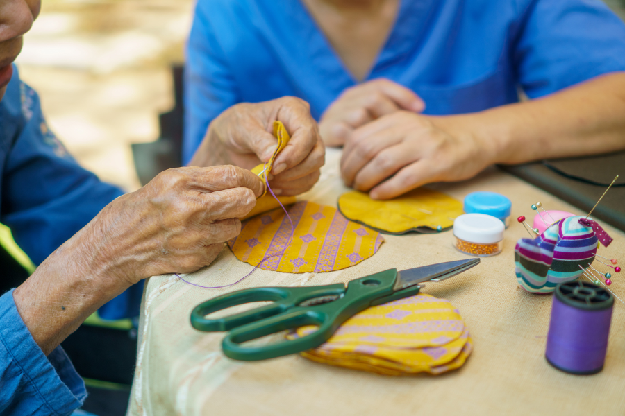 A patient sewing during occupational therapy